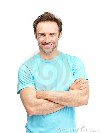 Happy mature man standing with folded hands