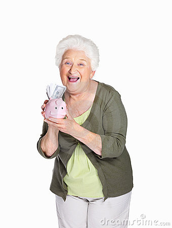 Happy mature woman holding piggy bank
