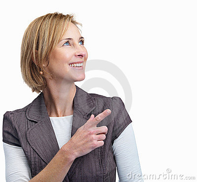 Happy mature woman pointing at copyspace
