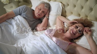 Happy mature woman waking up and smiling stock video