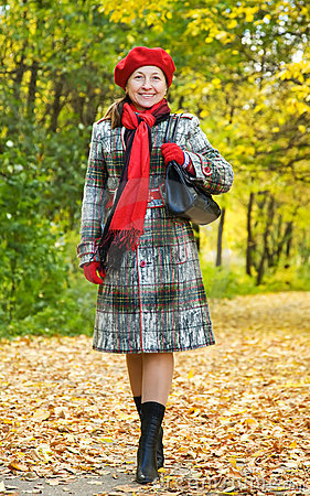Happy mature woman  walking in autumn