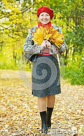 Happy mature woman  walking outdoors