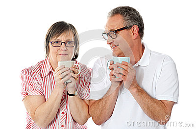Happy matured couple holding cofee mug