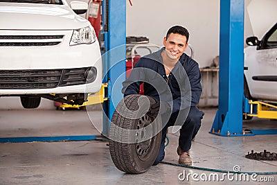 Happy mechanic loving his job