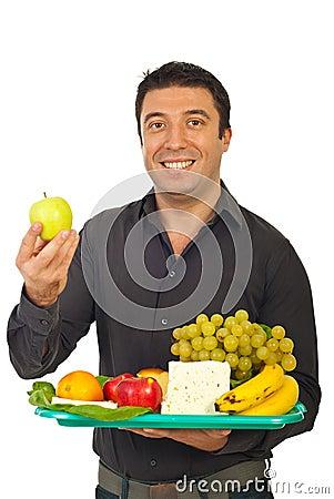 Happy mid adult man choose  green apple
