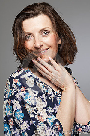 Happy middle age woman posing in studio.