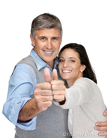 Happy middle aged couple gesturing thumbs up sign