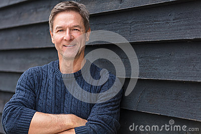 Happy Middle Aged Man Arms Folded Stock Photo