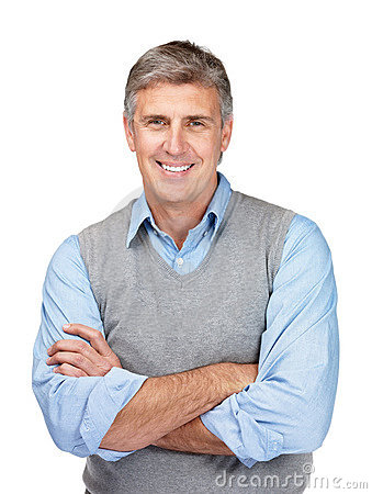 Happy middle aged man standing with folded hands