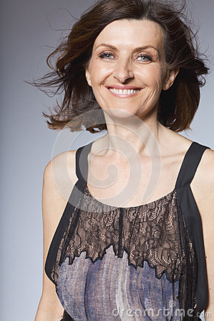 Happy middle-aged woman in long dress.