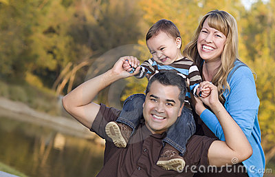 Happy Mixed Race Ethnic Family Outdoors