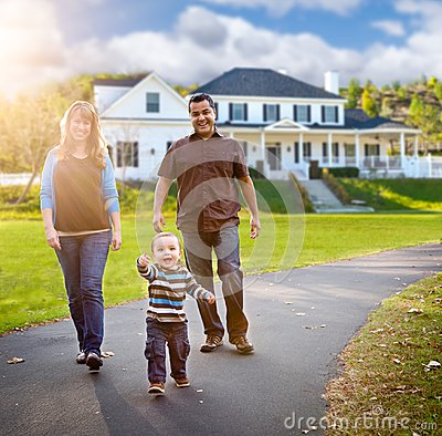 Free Happy Mixed Race Family Walking In Front Of Beautiful Custom Home Stock Photos - 111956523