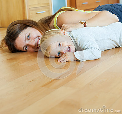 Free Happy Mom And Child On Wooden Floor Stock Image - 35589561