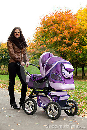 Happy mom with pram