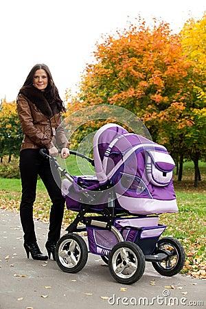 Happy mom with pram
