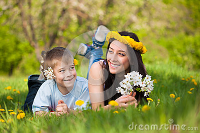Happy mom and son in a green park. summer