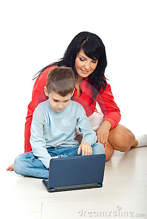 Happy mom and son with notebook