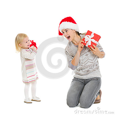 Happy mother and baby with Christmas present boxes