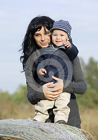 Happy mother and child in fall