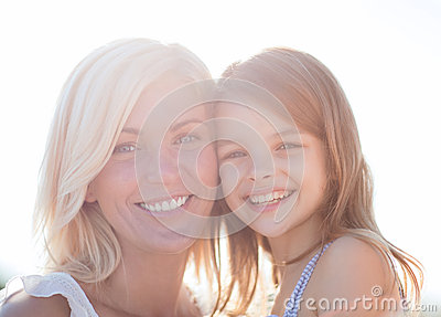 Happy mother and child girl