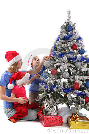 Happy mother and children over christmas tree