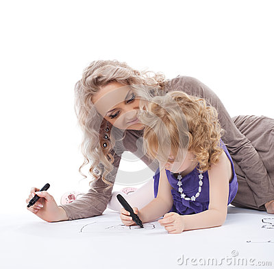 Happy mother and daughter draw