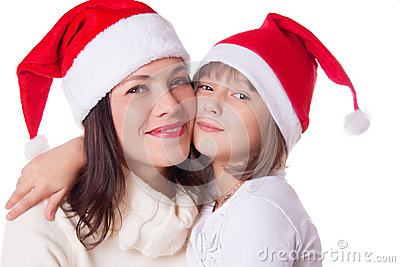 Happy mother and daughter hugging in Christmas hat