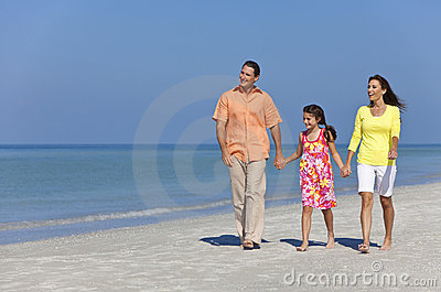 Happy Mother, Father and Daughter Family on Beach