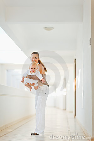 Happy mother having fun time with baby outdoor