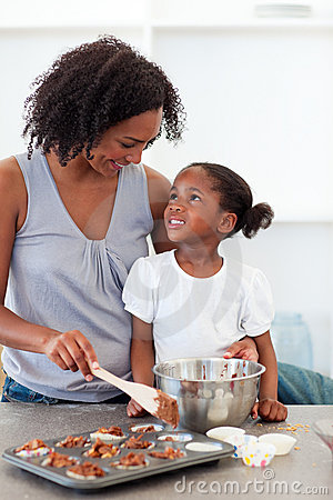 Free Happy Mother Helping Her Daughter Cooking Biscuits Royalty Free Stock Photography - 12402007