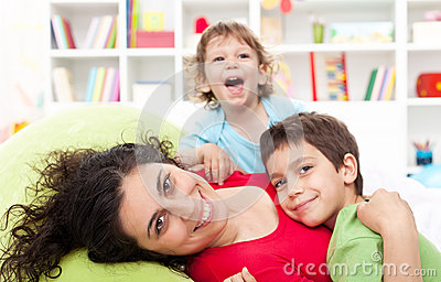 Happy mother and her children - motherhood