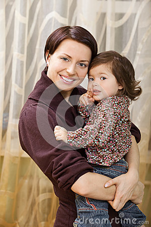 Happy mother holding child in arms