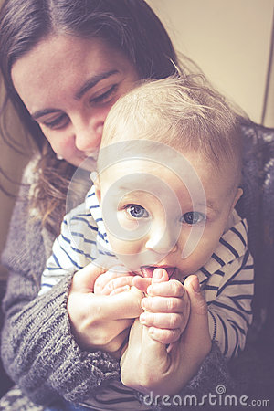 Free Happy Mother Hugging Her Naughty Baby Boy Stock Photo - 67036740
