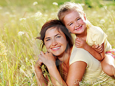 Happy mother and little daughter on nature