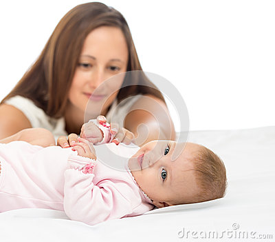 Happy mother looking at her baby infant