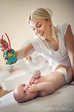 Free Happy Mother Playing With Her Little Baby Baby At Home. Royalty Free Stock Photography - 119391197