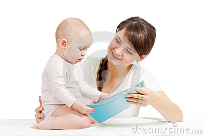 Happy mother reading to baby a book