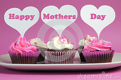 Happy Mother s Day message on pink and white decorated cupcakes