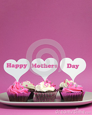 Happy Mother s Day message on pink and white decorated cupcakes - vertical with copy space