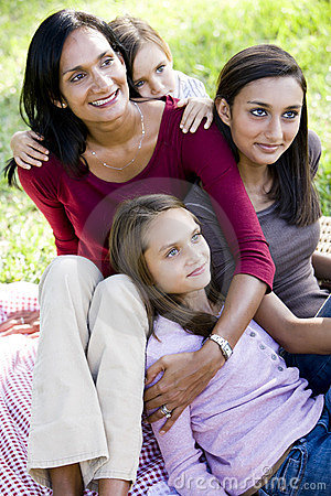 Happy mother with three beautiful children smiling