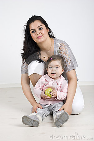 Free Happy Mother With Baby Girl Holding An Apple Stock Photos - 14064623