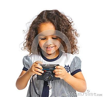 Happy mulatto girl with camera