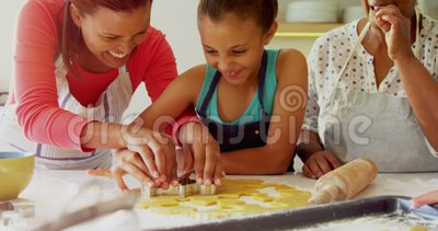 Happy multi-generation family preparing gingerbread in kitchen 4k stock video footage
