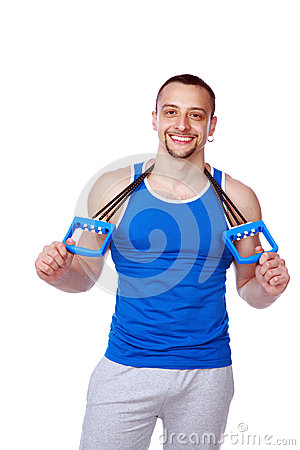 Happy muscular sportsman with expanders