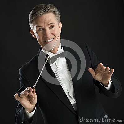 Happy Music Conductor Gesturing While Directing With His Baton
