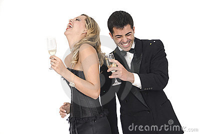 Happy new year or couple at a party laughing