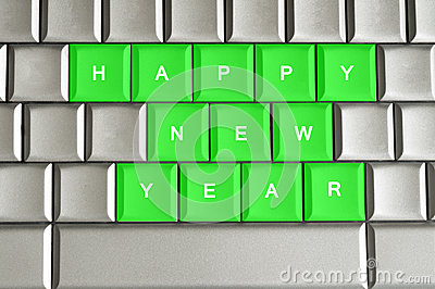 Happy New Year  spelled on a metallic keyboard