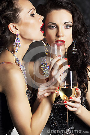 Happy new year with wineglasses of champagne