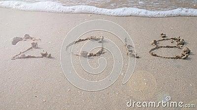 Happy new year 2018. 2018 write on sandy beach with wave splash Stock Photo