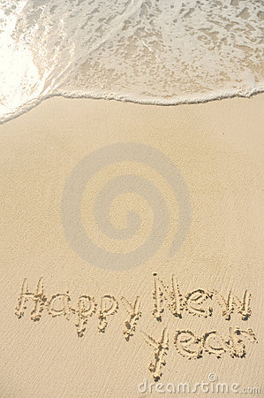 Happy New Year Written in Sand on Beach